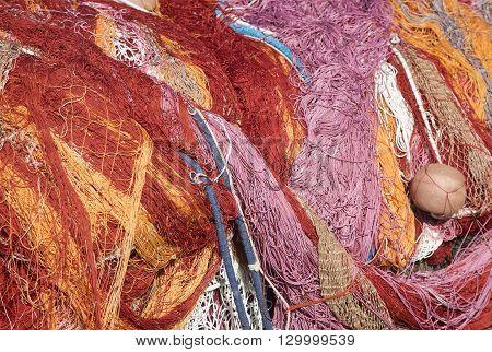 Mutli colored nylon fishing nets pile closeup
