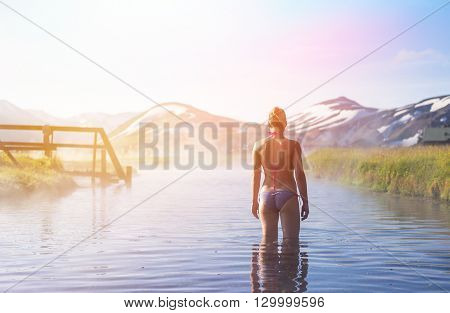 Woman enjoy hot spring. Iceland Landmannalaugar camping