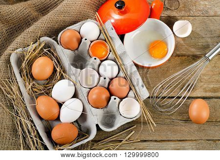 Raw Eggs On A  Rustic Wooden Background.