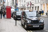 Black Cabs Parked In New Bond Street In London, Uk.
