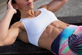 Fitness Woman Doing Crunches Outside poster
