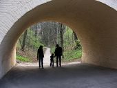 stock photo of fornication  - family in arch from spring wood - JPG
