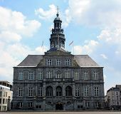 foto of city hall  - Maastricht City Hall with Blue Sky and white clouds - JPG