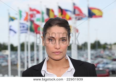 Woman stood in front of flags