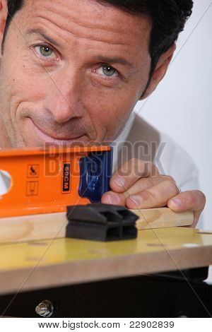 Closeup of a man using a laser lever