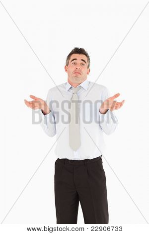 Portrait of a clueless businessman posing against a white background