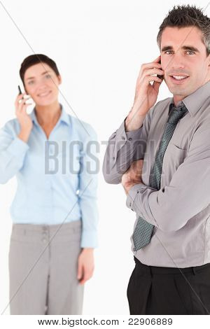 Portrait of a business people making a phone call against a white background