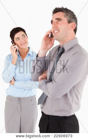 Portrait of office workers making a phone call against a white background