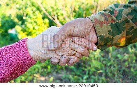 handclasp between elderly people outdoor