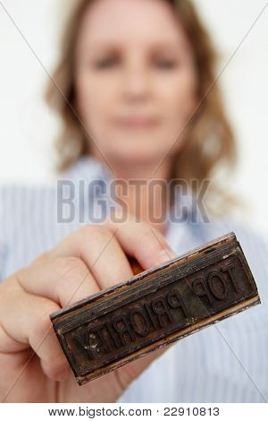 Businesswoman with rubber stamp
