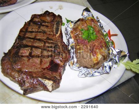 Mediun Rare Steak And Loaded Potato