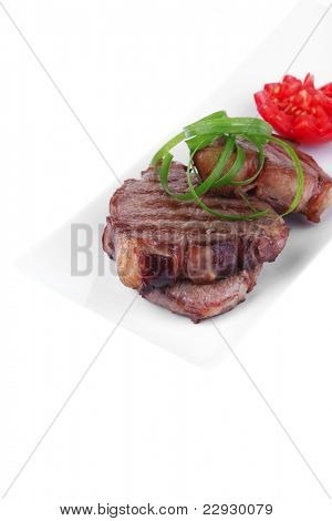 roast meat beef fillet strips on white plate isolated over white background