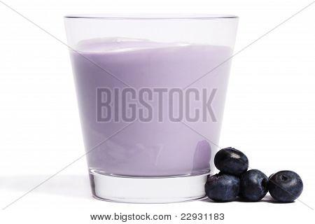 some blueberries near a milkshake