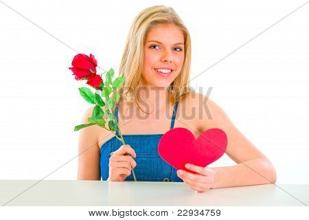 Lovely Girl Sitting At Table With Rose And Valentine Heart