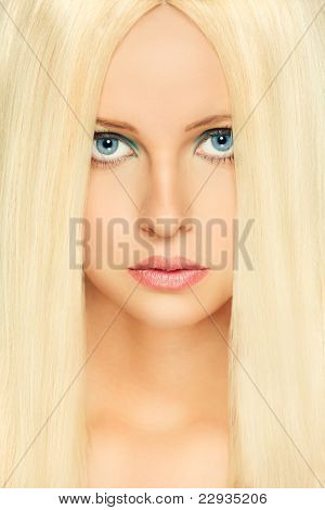 Portrait Of Blond Hair Woman With Blue Eyes. Retouched