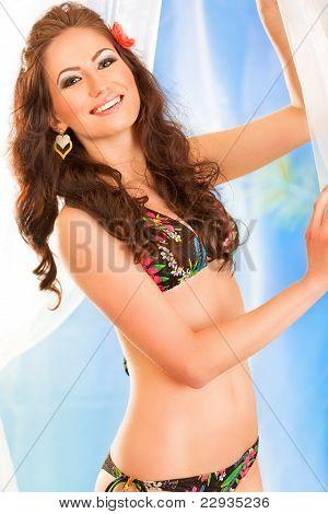 Smiling Pretty Girl In Bikini Posing In Summerhouse On Beach
