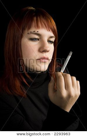 Girl Watching Her Cigarette