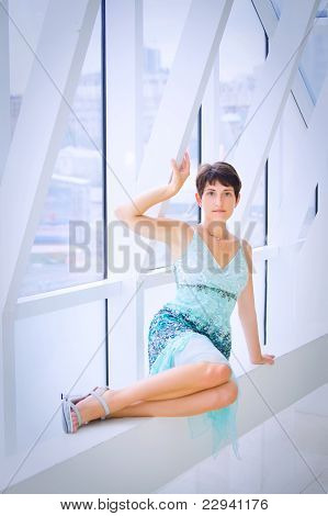 Woman at big window