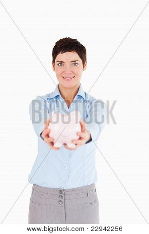 Office Worker Holding A Piggy Bank