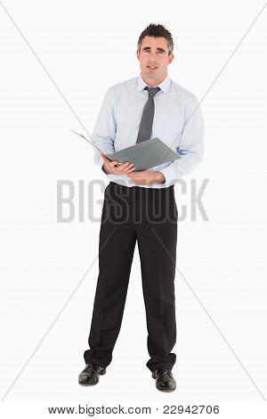 Businessman Holding A Binder