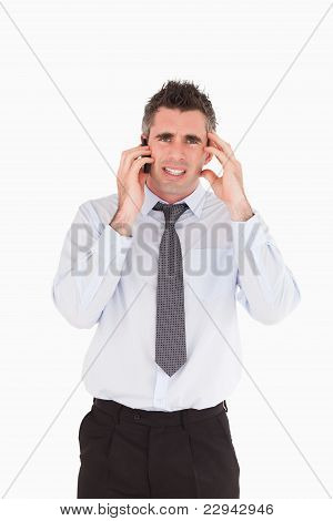 Portrait Of An Upset Man Making A Phone Call