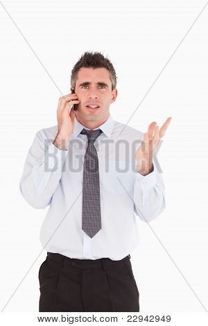 Portrait Of A Disappointing Man Making A Phone Call