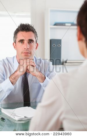 Portrait Of A Serious Manager Interviewing An Applicant