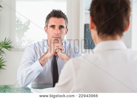 Handsome Manager Interviewing An Applicant