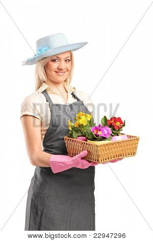 A young florist holding a basket with flowers isolated on white background