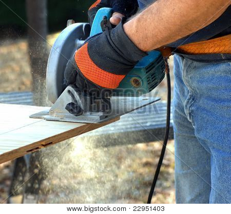 Carpenter Sawing