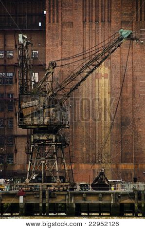 A rusty crane at the abandoned Battersea power station, London, UK