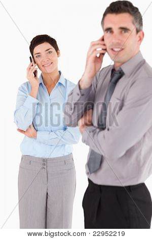 Portrait of a managers making a phone call against a white background