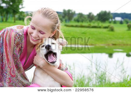 Girl Playing With A Puppy, Summer Day