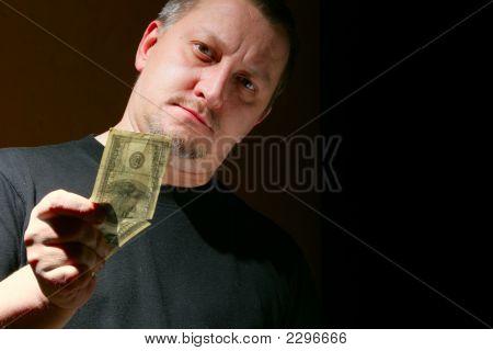 Man Offering Money Over Black Background