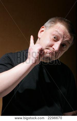 Man Shake One'S Thumb