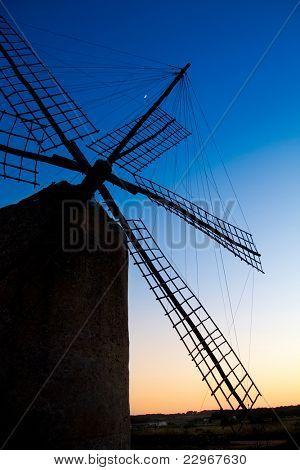 balearic islands windmill at sunset in Formentera La Mola