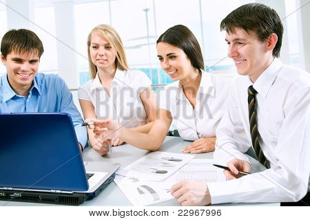 Group of business people looking at computer monitor