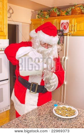 Santa pouring milk
