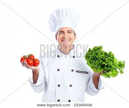 Smiling chef vith vegetables.  Isolated over white background. Gourmet.