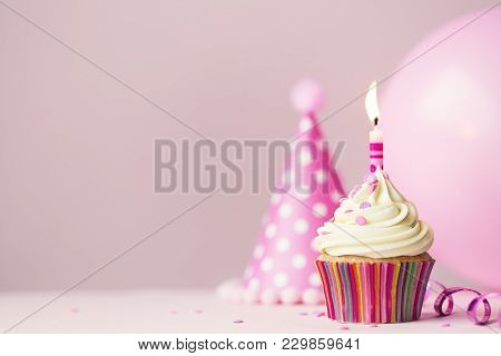 poster of Birthday cake with single candle and party balloon