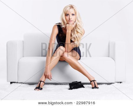 Blond Girl On Sofa