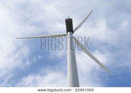 Energy windmill under sky