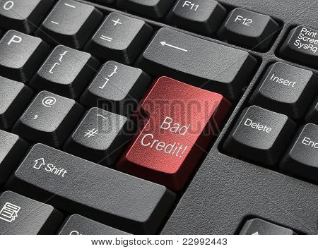 A Black Keyboard With Red Key Labelled Bad Credit