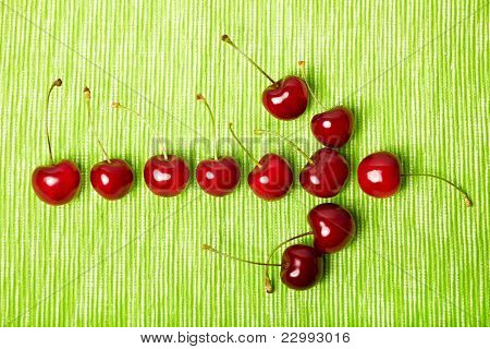 Arrow To The Right Made Of Cherries