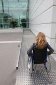 stock photo of premises  - woman in a wheelchair - JPG