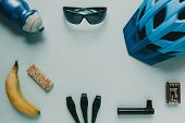 Cycling Accessories And Food With Copy Space On Blue Background. poster