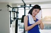 Young Asian Pretty Woman Wipes Sweat With Towel While Resting After Workout For Good Healthy With Ma poster