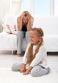 stock photo of temperance  - Little girl having a temper tantrum with her desperate mother in background - JPG