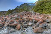 stock photo of landslide  - Image of rocks at the bottom of an alpine landslide - JPG