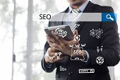 Searching Engine Optimizing Seo Browsing Concept, Businessman Holding Phone For Looking Information  poster